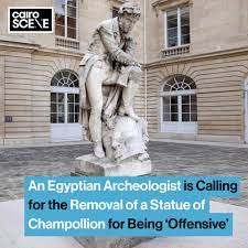 Cairo Scene - EGYPTIAN ARCHEOLOGIST URGES UNESCO AND THE FRENCH GOVERNMENT  TO REMOVE OFFENSIVE STATUE OF CHAMPOLLION STEPPING ON A PHARAOH'S HEAD With  the world confronting its racist colonial past after protests